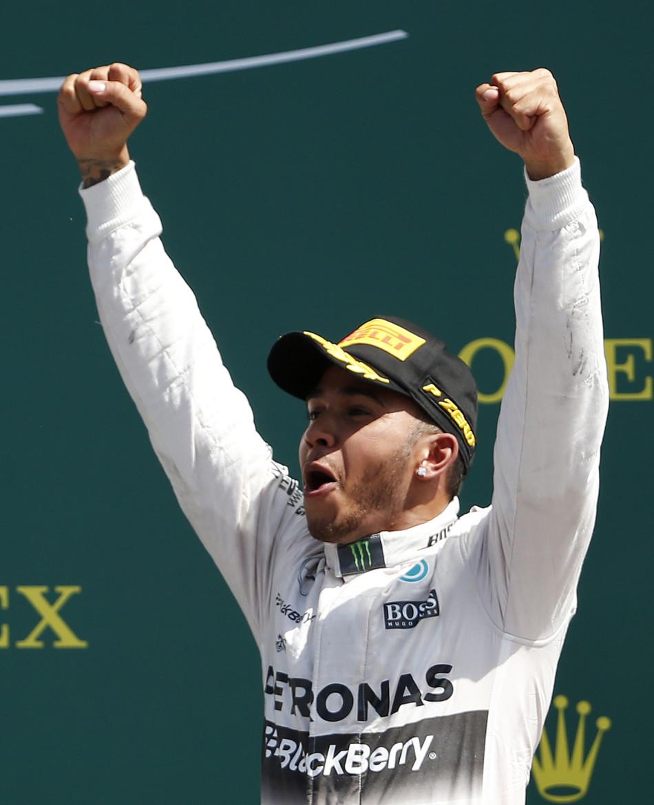 Formula One - F1 - British Grand Prix 2015 - Silverstone, England - 5/7/15 Mercedes' Lewis Hamilton celebrates his win on the podium Reuters / Phil Noble