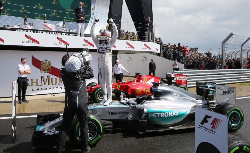 Formula One - F1 - British Grand Prix 2015 - Silverstone, England - 5/7/15 Mercedes' Lewis Hamilton celebrates his win Reuters / Paul Childs