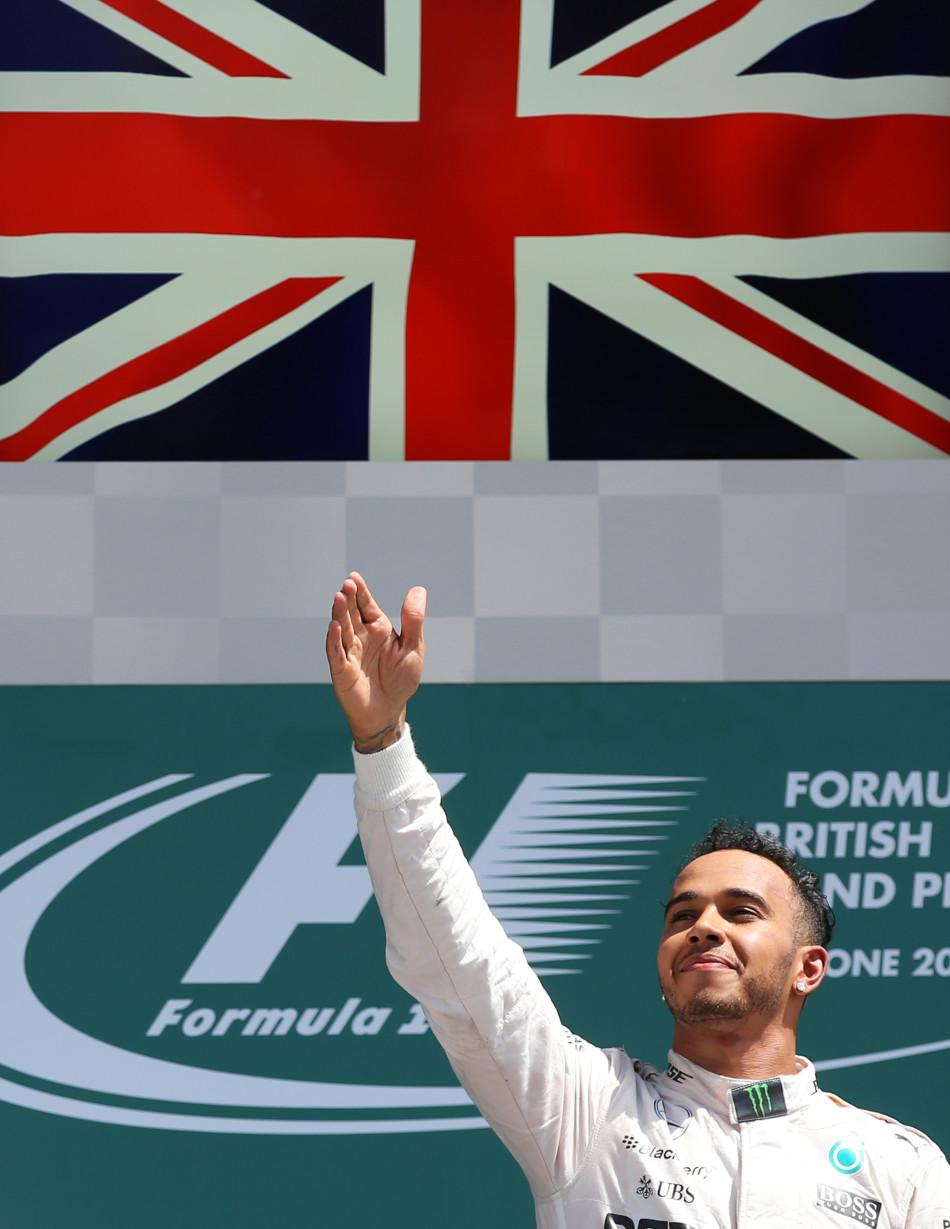 Formula One - F1 - British Grand Prix 2015 - Silverstone, England - 5/7/15 Mercedes' Lewis Hamilton celebrates his win on the podium Reuters / Paul Childs