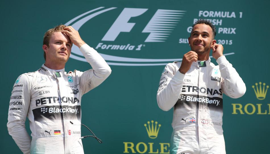 Formula One - F1 - British Grand Prix 2015 - Silverstone, England - 5/7/15 Mercedes' Lewis Hamilton celebrates his win on the podium with Nico Rosberg (L) Reuters / Paul Childs