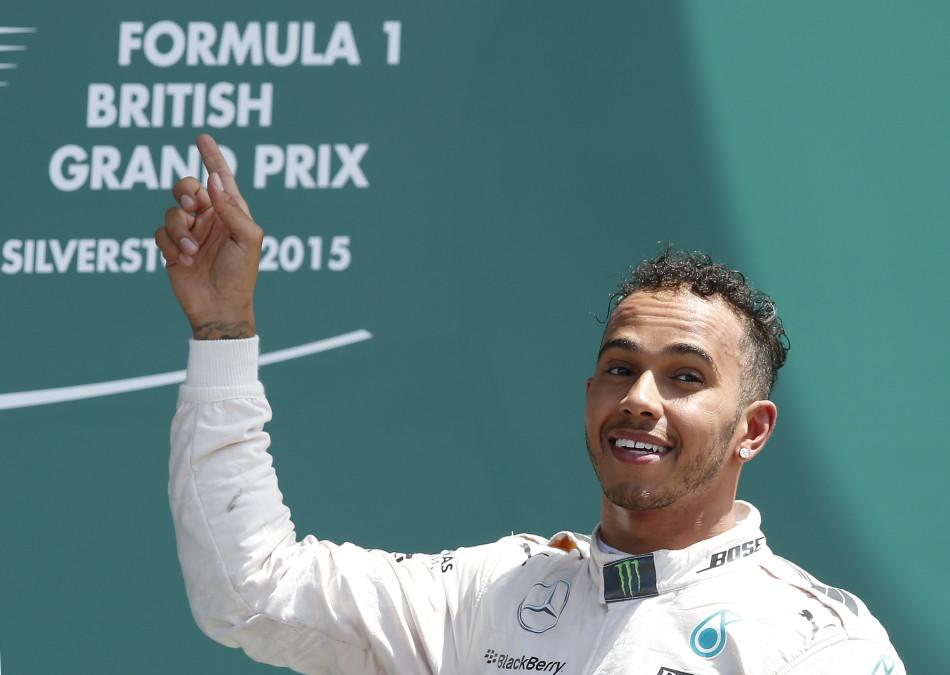 Formula One - F1 - British Grand Prix 2015 - Silverstone, England - 5/7/15 Mercedes' Lewis Hamilton celebrates his win on the podium Reuters / Andrew Yates